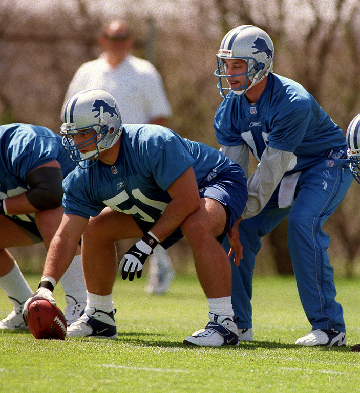 . Detroit Lions center Dominic Raiola (left, #51) prepares to snap the ball to quarterback Charlie Batch (#10)  during the Lions morning session of mini camp, Friday, April 27, 2001, at the Lions practice facility in Pontiac, Mich.  Raiola was the second round draft choice for the Lions this year.
