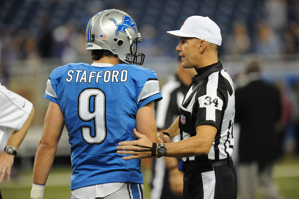 . Detroit Lions quarterback Matthew Stafford, left, chats with Referee Clete Blakeman prior to the start of the Lions/Vikings game.  Photo taken on Sunday, September 30, 2012, at Ford Field in Detroit, Mich.  (Special to The Oakland Press/Jose Juarez)