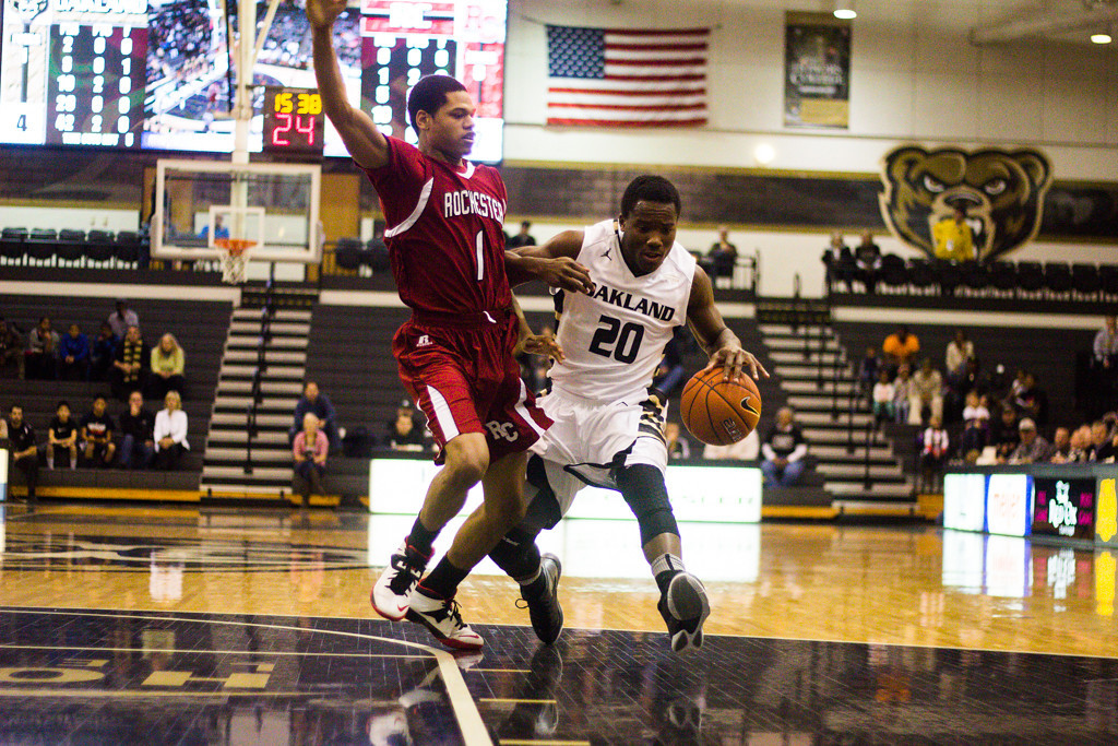 . Felder pushes past his Rochester College defender. Photo by Dylan Dulberg