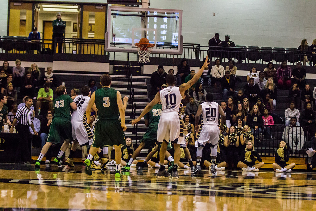. Oakland guard Duke Mondy sinks a 3-pointer in the second half Tuesday, Oct. 29, 2013 at the Athletics Center O\'rena. Photo by Dylan Dulberg