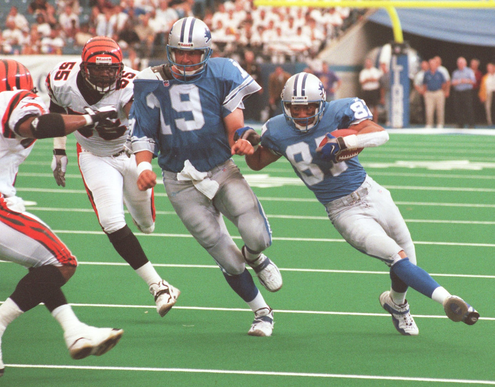 . Detroit Lions quarterback Scott Mitchell (19) leads the block for teammate Johnnie Mortan (87) during the first quarter during Sunday\'s game played against the Cincinnati Bengals at the Pontiac Silverdome. Lions lost 34- 28 in overtime.