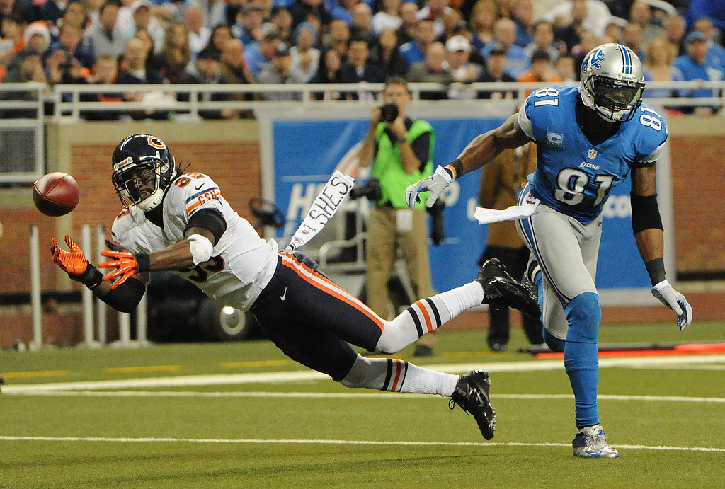 . Detroit Lions wide receiver Calvin Johnson (81) is unable to haul in a catch as Chicago Bears cornerback Charles Tillman almost intercepts the ball during third quarter action.  The Bears beat the Lions, 26-24.  Photo taken on Sunday, December 30, 2012, at Ford Field in Detroit, Mich.  (Special to The Oakland Press/Jose Juarez)